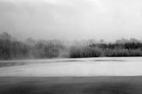 Winter landscape. The ice on the river. The mist over the water. Low air temperature. - 238124644