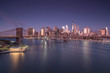 Aerial view on East river with Brooklyn Bridge and financial district at night,long exposure