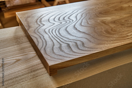 Foto op Plexiglas Stenen in het Zand Slab table top of elm. Woodworking and carpentry production. Furniture manufacture
