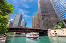 Chicago Downtown And Chicago River With Bridge And With Tourist Ship During Sunny Day, Chicago, Illinois.