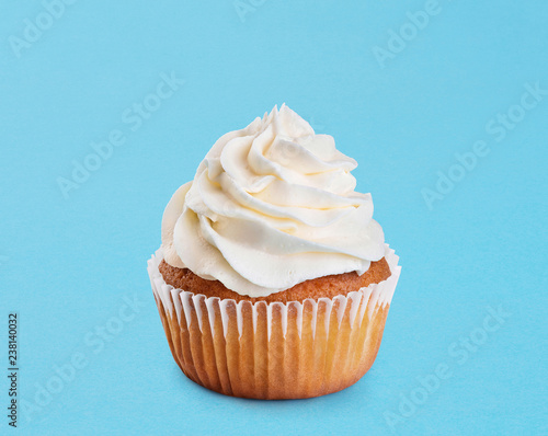 Cupcake on a blue background. Wallpaper Mural