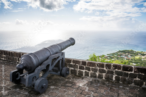 Cannon faces the Caribbean Sea at Brimstone Hill Fortress on Saint Kitts Wallpaper Mural
