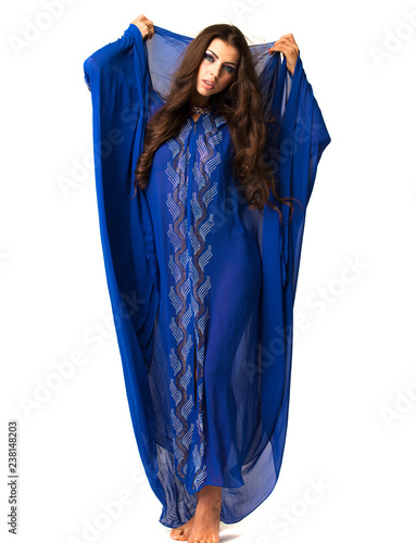 Fényképezés  Young arabic woman in long blue dress