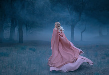 Gorgeous Young Queen With Blond Hair Runs In A Dark And Dense Scary Forest Full Of White Mist, Dressed In A Long, Flying And Flowing Peach Dress, A Photograph Of A Beautiful Woman In The Moonlight