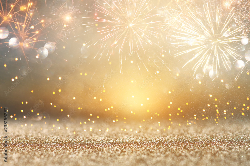 Fototapeta abstract gold glitter background with fireworks. christmas eve, new year and 4th of july holiday concept.