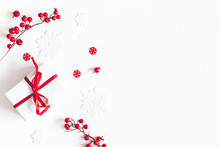 Christmas Composition. Frame Made Of Gift, Snowflakes, Red Berries On White Background. Christmas, Winter, New Year Concept. Flat Lay, Top View, Copy Space