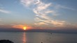 Sunset on the sea with ship on the horizon, timelapse