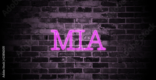 Photo  first name Mia in pink neon on brick wall