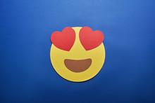 Top View Of In Love Emoji On B...