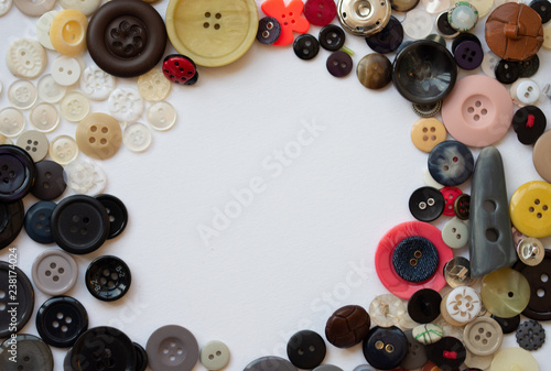 Fotografering  Assorted buttons arranged in a circle frame with space for text