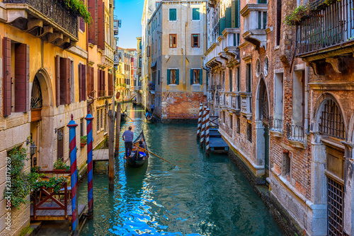 Stickers pour porte Venise Narrow canal with gondola and bridge in Venice, Italy. Architecture and landmark of Venice. Cozy cityscape of Venice.