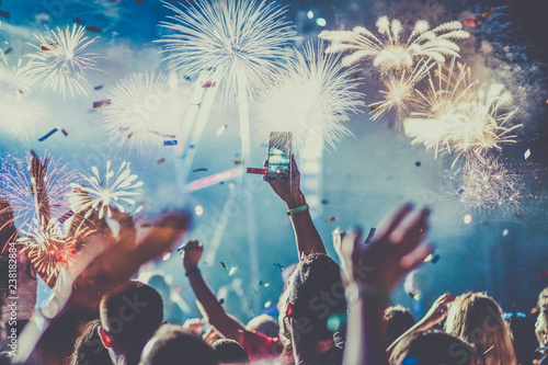 Photo  crowd watching fireworks - New Year celebrations- abstract holiday background