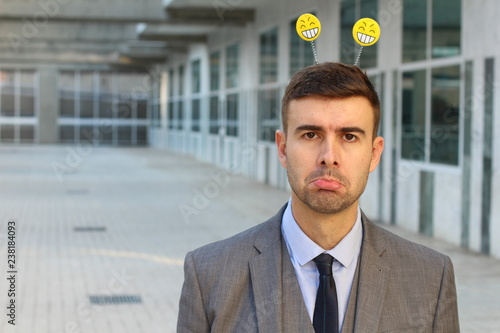 Capricious businessman feeling moody at work Tablou Canvas