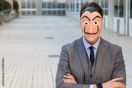 Elegant businessman with a mask