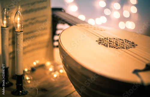 Lute with instrumental sheet music and soft lights for Christmas holiday, split Canvas Print