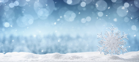 Winter background, crystal snowflake in the snow with copy space