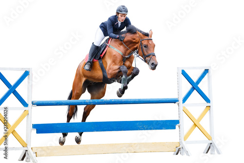 Young woman riding horse on show jumping contest Fototapeta