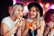 canvas print picture - Female friends eating and drinking at music festival