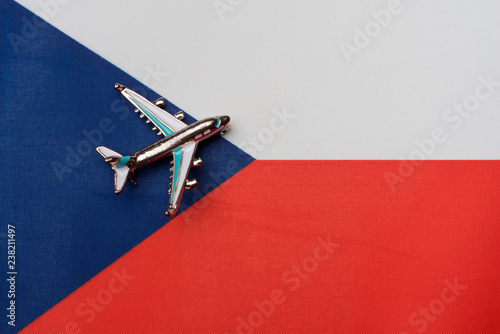 Photo  The plane over the flag of the Czech Republic, the concept of travel