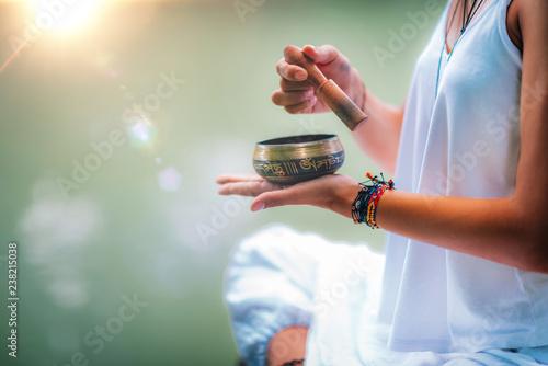 Obraz Young woman with Tibetan Singing Bowl - fototapety do salonu