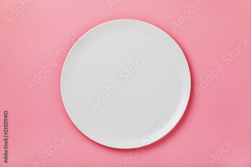 White ceramic tray on the pink table, top view. Food background - 238215403