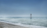 Smooth sea surface and the iron tower in the water. Long exposure, minimalism. - 238215885