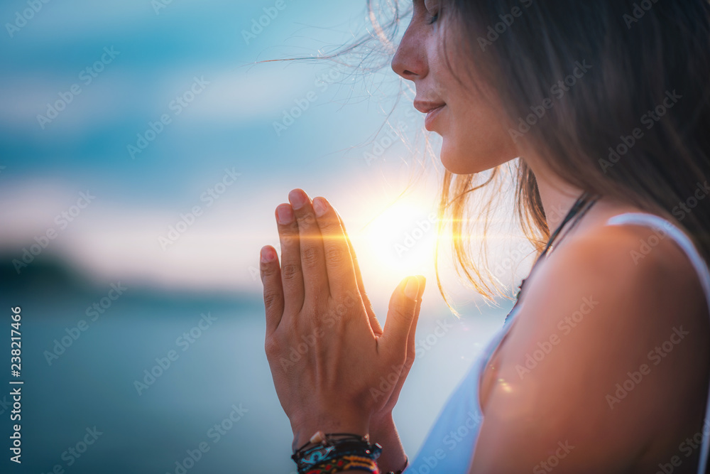 Fototapeta Meditating. Close Up Female Hands Prayer