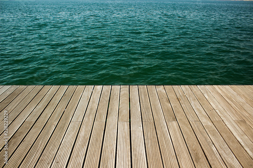 Fototapeta wooden deck floor surface waterfront perspective background texture and sea vivid blue water, copy space obraz na płótnie