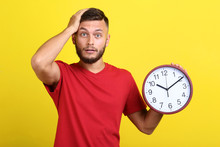 Young Man With Round Clock On ...