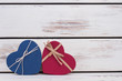 Heart-shaped gift boxes with copy space. Valentine holiday gifts on wooden background. Give presents with love.