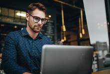 Man Working On Laptop Sitting ...