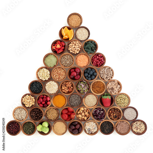 Foto op Aluminium Assortiment Super food concept for healthy living in a pyramid shape including fruit, vegetables, herbs, spices, supplement powders, grains and cereals, high in antioxidants, anthocyanins, dietary fibre and vitam