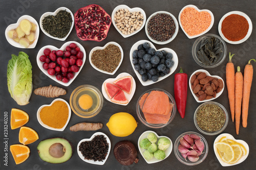 Foto op Aluminium Assortiment Super food to slow the ageing process concept including fish, fruit, vegetables, nuts, green & black tea, herbs, spices and dairy. High in antioxidants, anthocyanins, dietary fibre & vitamins.