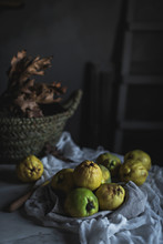 Guava And Autumn Leaves On Table