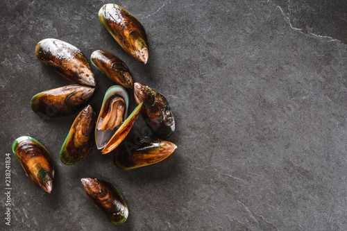 Valokuva  Fresh raw mussels on slate stone background