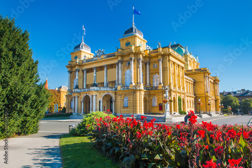 Poster Theater Croatia, Zagreb, beautiful historic national theater building and flowers in park, blue sky, summer day, popular tourist destination