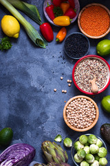 Healthy vegan cooking ingredients, fresh vegetables, chickpeas, quinoa, lentils, clean eating concept, flat lay