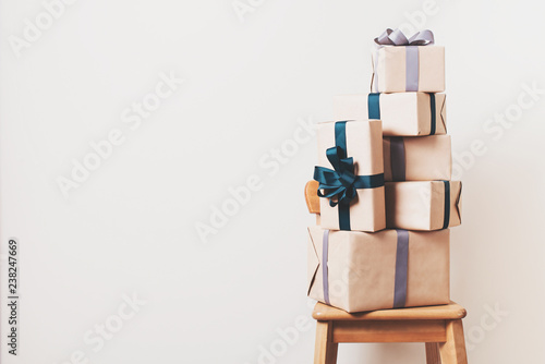 Scandinavian minimalism christmas and new year concept - gift box on a chair in room