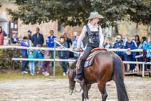 Cowgirl Riding Horse Backwards
