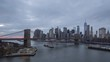 Skyline of Lower Manhattan and Brooklyn Bridge in the Evening, New York City. Day to Night Time Lapse
