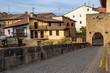 Puente la Reina urban skyline with the Romanesque bridge across Arga River and a bridge gate, in Navarre Spain