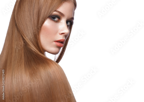 Valokuva  Beautiful blond girl with a perfectly smooth hair, classic make-up