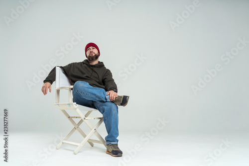 male casting director sitting on a folding chair
