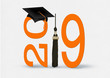 canvas print picture - black graduation cap and tassel with bold orange 2019 numbers on soft white textured background