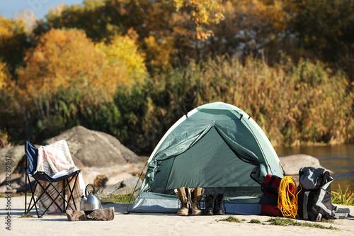 Set of equipment near camping tent outdoors Fototapeta