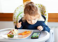 Toddler Eats While Watching Mo...