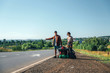 Hitchhiking couple. Backpackers on road