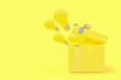 Leinwandbild Motiv The light bulb drifted out of the gift box yellow color
