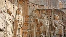 Longmen Grottoes : Massive Buddhist Sculptures At Main Grotto Fengxiansi Cave. The World Heritage Site, Chinese Buddhist Art. Located In Louyang, Henan Province China. Selective Focus.