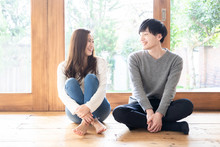 Young Asian Couple Relaxing In...